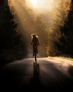 girl on bike on road
