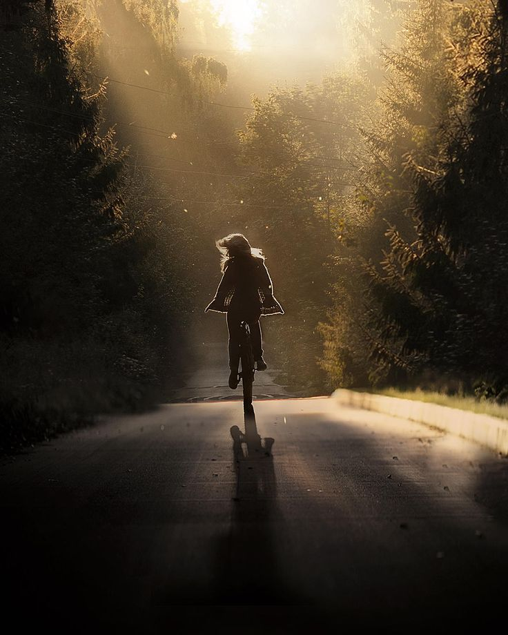 girl on bike on road