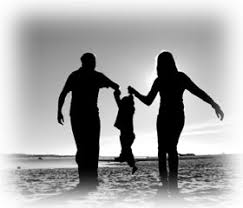 parents with child on beach